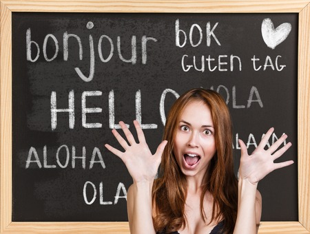 chineese: Woman near words hello in different languages on chalkboard