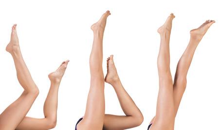long feet: Beautiful female legs isolated on white background Stock Photo