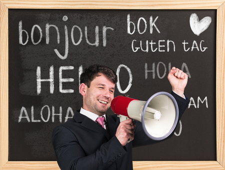 language learning: Woman near words hello in different languages on chalkboard