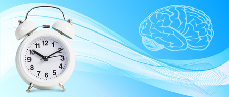 abstract alarm clock: Classical alarm clock stands on the blue abstract background