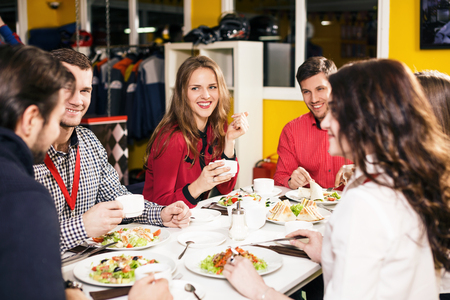 banquet: Group of people sitting at the decorated catering banquet table Stock Photo