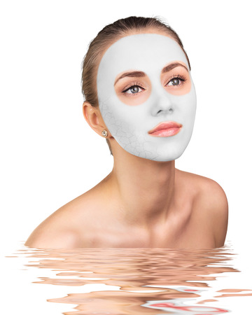 Young woman with clay face mask on her face Foto de archivo
