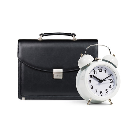 black briefcase: Classical alarm clock and black briefcase stands isolated on white Stock Photo