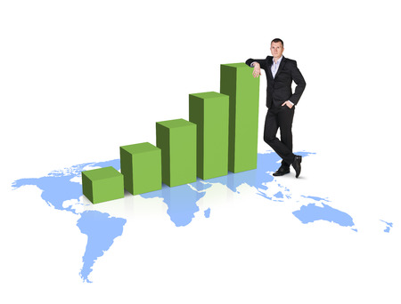 enterprising: Businessman stands near growth up graph on the map isolated on white. Stock Photo