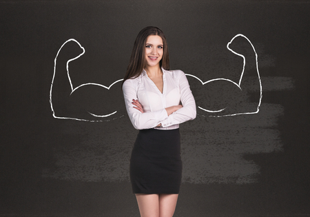 autocratic: Business woman with drawn powerful hands. Black chalkboard background.