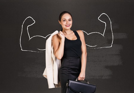 dictatorial: Business woman with drawn powerful hands. Black chalkboard background.