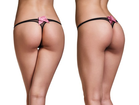 female buttocks: Perfect female buttocks in black thong isolated on whit background Stock Photo