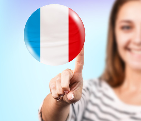 Young woman point on the bubble with french flag Stock Photo