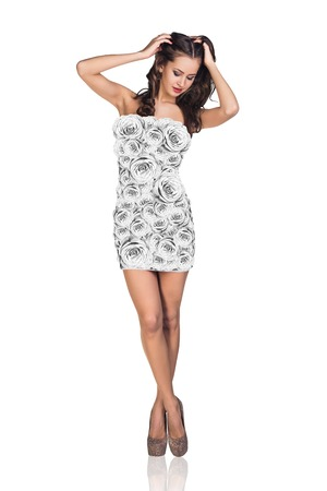 blue romance: Beautiful young woman in white roses dress isolated on white