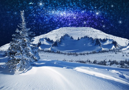starlight: Fantastic winter starlight night and the snow mountains Stock Photo