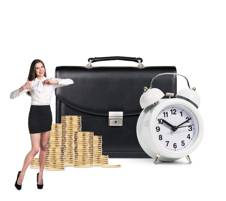 black briefcase: Business woman stands near alarm clock ,black briefcase and coins isolated on white