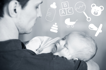 holds: Happy young father holds sleep new born baby on hands
