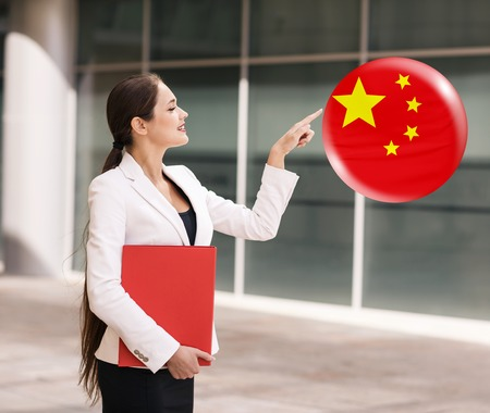 Young business woman point on the bubble with chinese flag