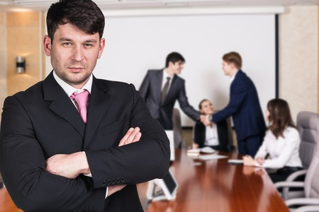 potrait: Potrait of business woman closeup with business people shaking hands, finishing up a meeting Stock Photo