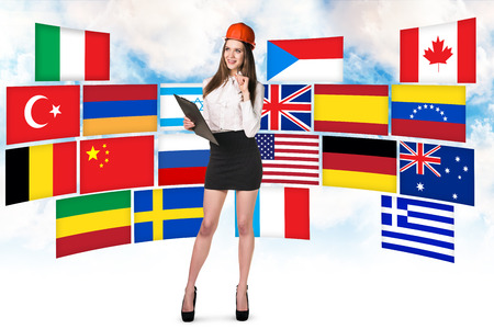 different countries: Business woman stands on the many different countries flags background