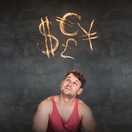 Man and currency symbols overhead blazing on the gray background