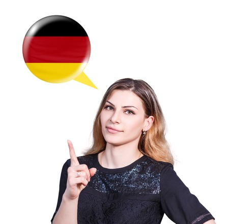 fluency: Young woman point on the bubble with german flag. Learning of foreign languages concept.