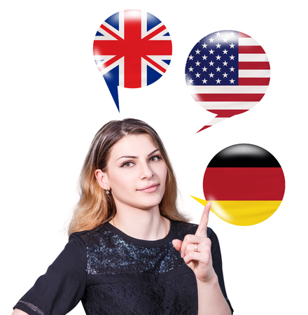 fluency: Young woman surrounded by bubbles with different countries flags.Learning of foreign languages concept. Stock Photo