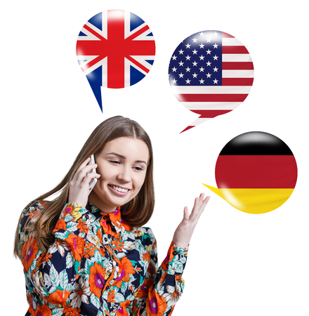 fluency: Young woman surrounded by bubbles with different countries flags. Learning of foreign languages concept.