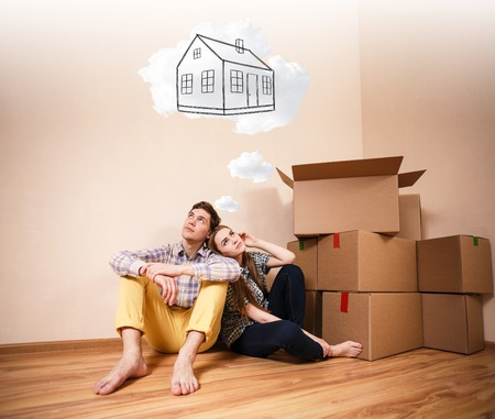 daydream: Young couple sitting on the floor and daydream about new home