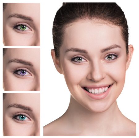 Beautiful female eyes close up in color contact lenses