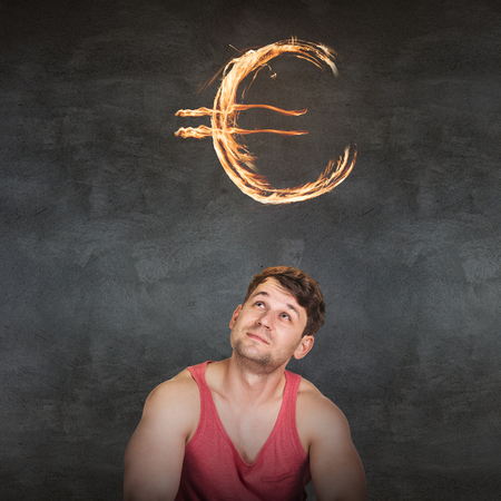 fervent: Man and currency symbol overhead blazing on the gray background Stock Photo