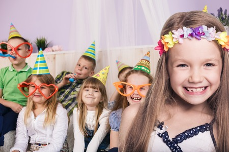Happy smiling children celebrating birthday party at home