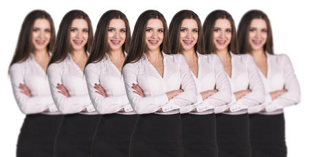 alike: Group of business women clones standing in a row Stock Photo