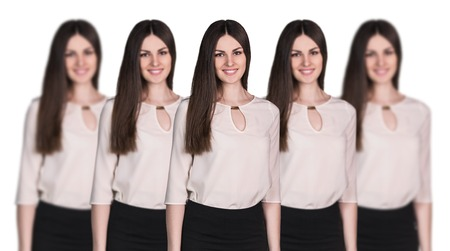 clones: Group of business women clones standing in a row Stock Photo