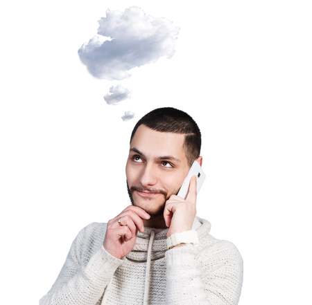 daydream: Young man daydream and speak on the phone with white cloud owerhead isolated on white