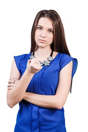 threaten: Strict beautiful woman shows threaten fist isolated on white