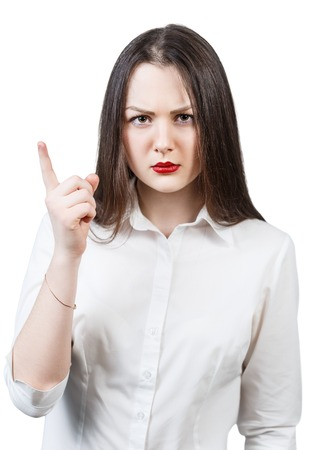 threaten: Young angry woman threaten finger isolated on white background Stock Photo