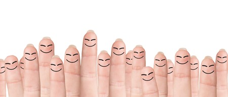 cohesion: Many fingers with drawn faces stands on the green background