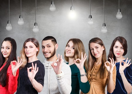 happy business team: Business people showing OK sign isolated on white background