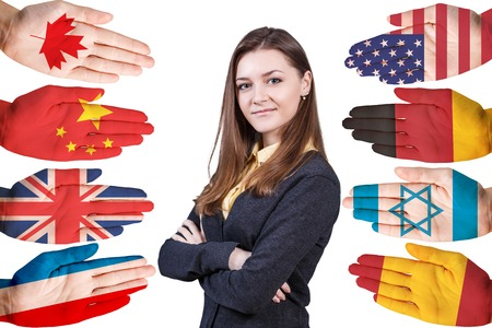 nationality: Young woman and many hands with different country flags painted on them isolated on white