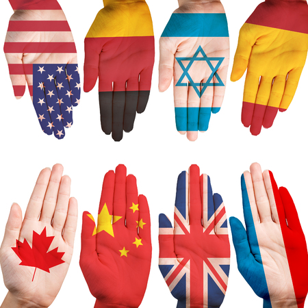 Many hands with different country flags painted on them isolated on white