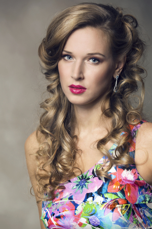 summer beauty: Beautiful model with long curly hair and professional make-up. Fashion makeup and Hairstyle curls