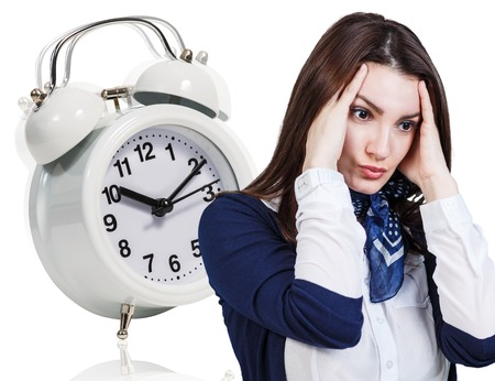 Business woman with a headache and alarm clock isolated on the white