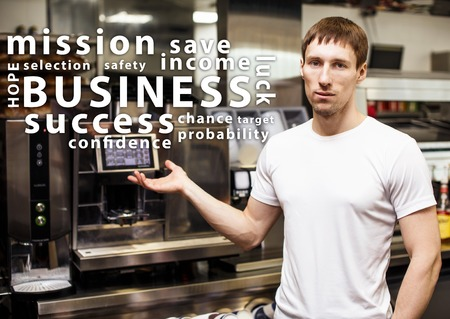 coffeeshop: Portrait of worker in coffeeshop shows equipment and words cloud
