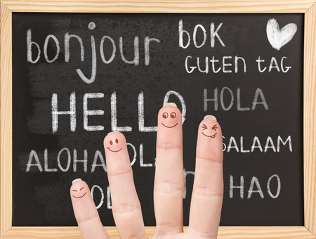 guten tag: Hello in various languages on a black chalkboard