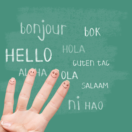 bonjour: Hello in various languages on a green chalkboard Stock Photo