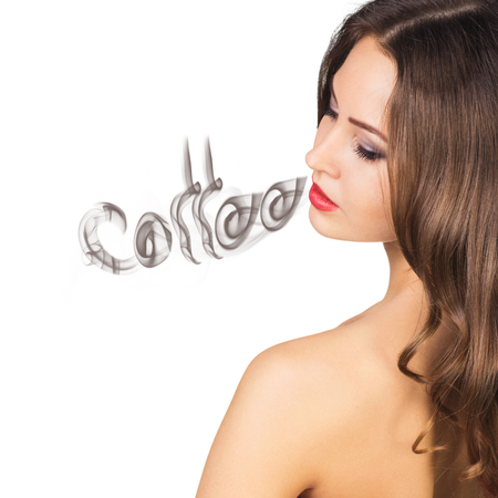 inhaling: Young woman inhaling coffee aroma isolated on white Stock Photo