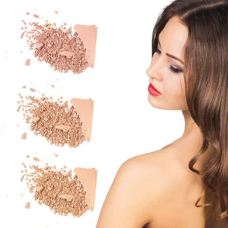 skin color: Beauty portrait of a young girl with loose powder isolated on white Stock Photo