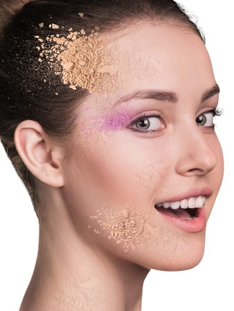 crumbly: Woman face with crumbly powder isolated on white background