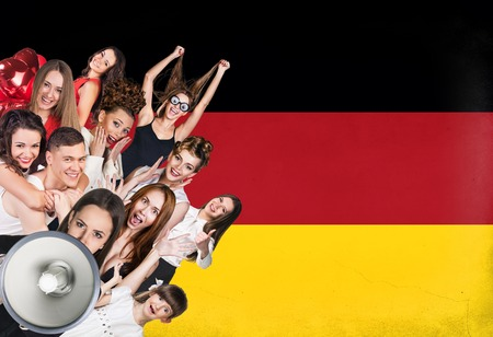 dutch girl: Happy group of diverse students standing on the german flag background