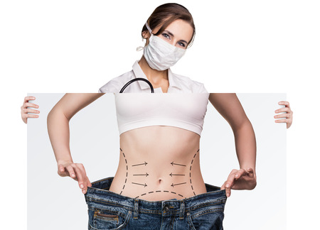 correction lines: Female doctor holds placard with woman battocks and correction lines on them. Plastic surgery concept.