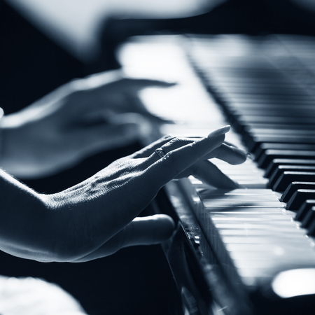 piano closeup: Womans hands on the keyboard of the piano closeup Stock Photo