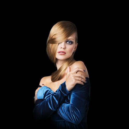 shiny black: Fashion stylish beauty portrait of woman with blonde hair isolated on black background.