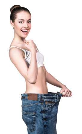 oversize: Woman became skinny and wearing old big jeans Stock Photo