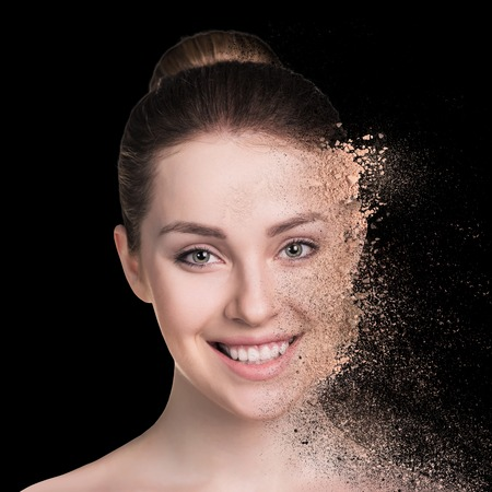 crumbly: Woman and crumbly powder on the black background Stock Photo